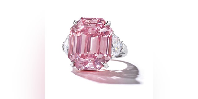 The pink legacy diamond is seen above.