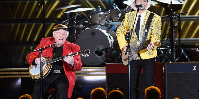 Roy Clark and Brad Paisley perform onstage at the 50th annual CMA Awards at the Bridgestone Arena