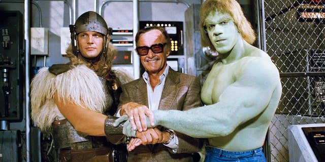FILE - In this May 9, 1988, file photo, comics impresario Stan Lee, center, poses with Lou Ferrigno, right, and Eric Kramer who portray 'The Incredible Hulk' and Thor, respectively, in a special movie for NBC, 'The Incredible Hulk Returns,' May 9, 1988, Los Angeles, Calif.