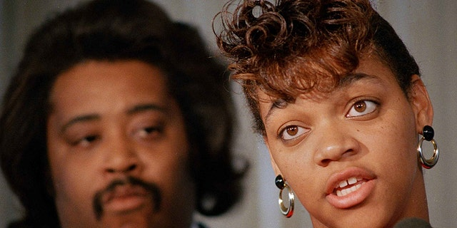 In this 1988 file photo, Tawana Brawley speaks to reporters with her adviser the Rev. Al Sharpton in Chicago.