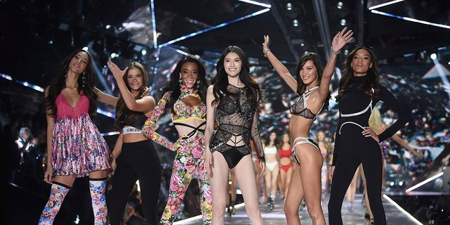 Models Yasmin Wijnaldum, left, Barbara Palvin, Winnie Harlow, Sui He, Bella Hadid and Lameka Fox walk the runway during the 2018 Victoria's Secret Fashion Show at Pier 94 on Thursday, Nov. 8, 2018, in New York.