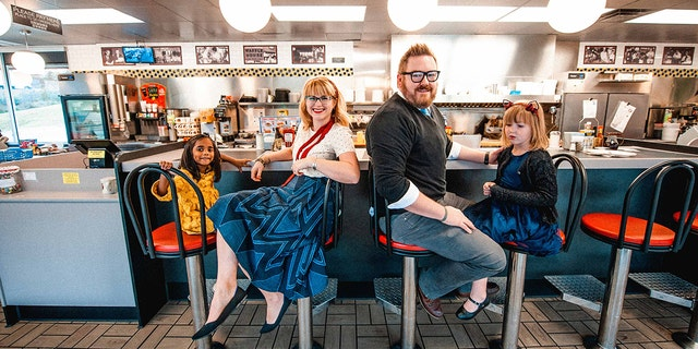 The Nichols family honored their love of the breakfast chain with a Christmas photo shoot.