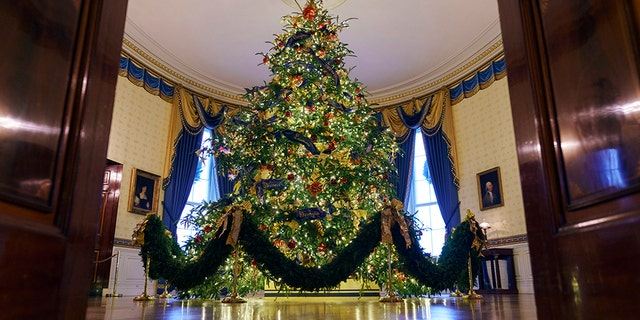 The official White House Christmas tree is seen in the Blue Room during the 2018 Christmas Press Preview at the White House.