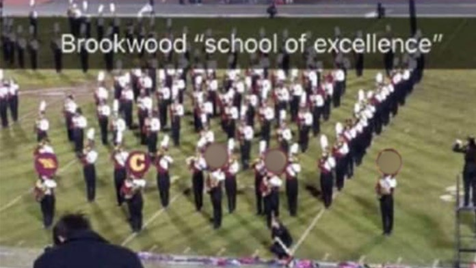 Image result for marching band spells out racial word