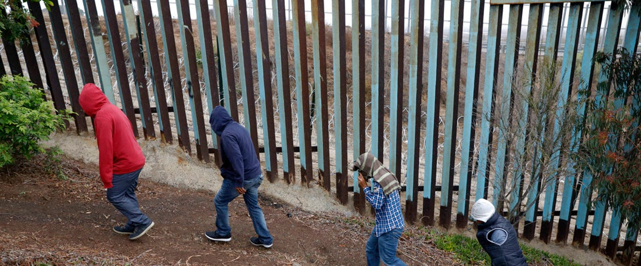 Pregnant caravan migrant scales border wall, gives birth on American soil