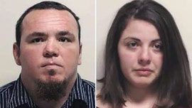 Couple held in waterboarding of girl, 9, police say