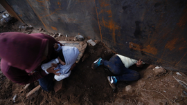 AP PHOTOS: Migrants in Tijuana trickling over and under wall