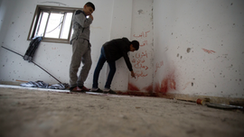The Latest: Israeli troops seal off Ramallah to find shooter