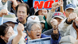 Japan begins reclamation at disputed US base despite protest