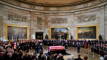 As Washington remembered Bush, politics in the Capitol was on hold -- sort of