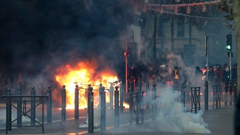 Paris tries to clean up after protests; French officials call for unity