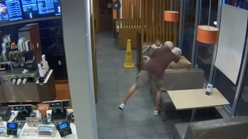 McDonald's customer nearly run over after chasing man who stole her purse inside restaurant