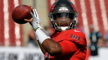 Tampa Bay Buccaneers' Jameis Winston lets trick shot golfer use his head as tee