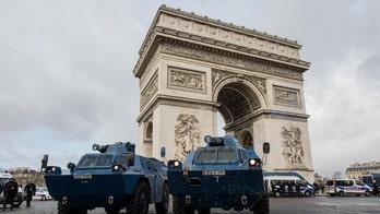 Police, protesters clash in Paris