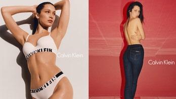 Calvin Klein responds to backlash over Bella Hadid, female robot kiss
