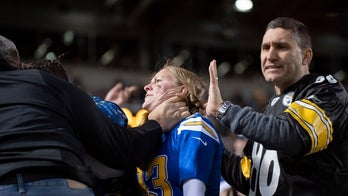 Steelers fan chokes pregnant Chargers fan at game, photos and video show