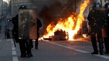 Paris cleans up after riots as pressure builds on Macron