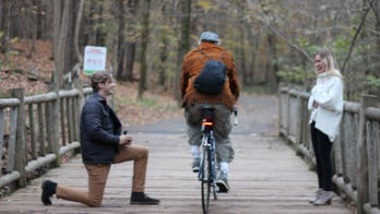 Cyclist photobombs Kentucky couple's engagement photos: 'What in the world was this guy thinking?'