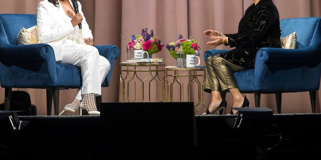 """Former first lady Michelle Obama, left, is interviewed by Elizabeth Alexander during the """"Becoming: An Intimate Conversation with Michelle Obama"""" at Barclays Center in Saturday, Dec. 1, 2018, in New York. (AP Photo/Mary Altaffer)"""