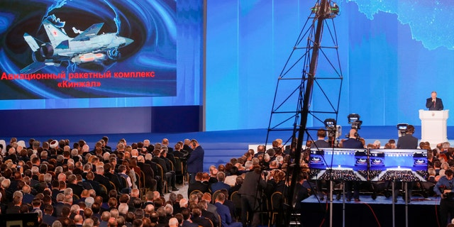 The video screen shows the Kinzhal missile system as Russia's President Vladimir Putin delivers an annual address to the Federal Assembly of the Russian Federation, at Moscow's Manezh Central Exhibition Hall.