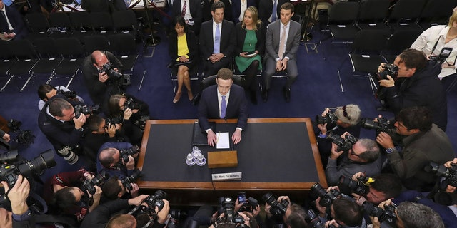 Facebook's Zuckerberg under fire as shareholders are urged to remove him as board chair