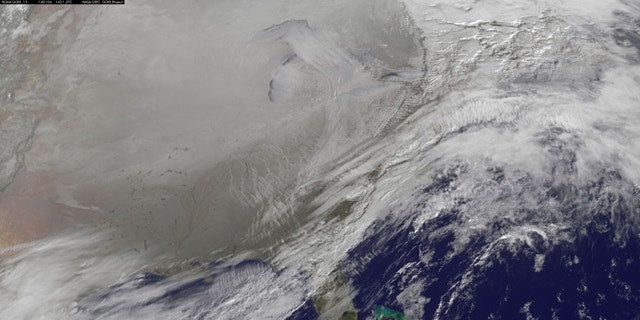 This Jan. 6, 2014 photo shows a satellite image of a polar vortex pushing southward over the U.S.