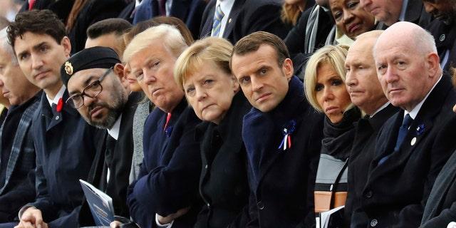 Världsledare, inklusive president Donald Trump, Tysklands kansler Angela Merkel och Frankrikes president Emmanuel Macron, var i Paris som en del av jubileerna som markerade 100-årsjubileet för 11 november 1918, vapenvapen, som avslutade första världskriget (Ludovic Marin / Poolfoto via AP)