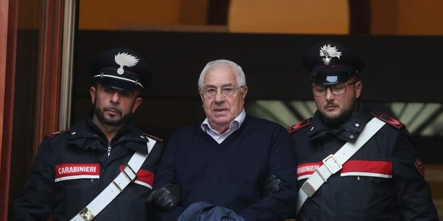 Settimino Mineo, center, who allegedly took over as the Palermo head of Cosa Nostra, is escorted by Italian Carabinieri police after an anti Mafia operation which led the arrest of 46 people including the presumed regional boss, in Palermo, Sicily, Italy, Tuesday, Dec. 4, 2018. Italian police say they have dismantled the rebuilt upper echelons of the Sicilian Mafia.