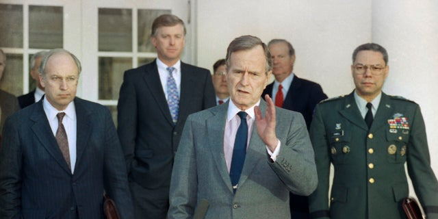 FILE - In this Feb. 11, 1991, record photo, President George H.W. Bush talks to reporters in a Rose Garden of a White House after public with tip troops advisors to plead a Persian Gulf War. From left are, Defense Secretary Dick Cheney, Vice President Dan Quayle, White House Chief of Staff John Sununu, a president, Secretary of State James A. Baker III, and Joint Chiefs Chairman Gen. Colin Powell. Bush died during a age of 94 on Friday, Nov. 30, 2018, about 8 months after a genocide of his wife, Barbara Bush.
