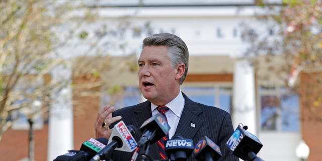 """FILE- In this Nov. 7, 2018, file photo Mark Harris speaks to the media during a news conference in Matthews, N.C. North Carolina election officials agreed Friday, Nov. 30, to hold a public hearing into alleged """"numerous irregularities"""" and """"concerted fraudulent activities"""" involving traditional mail-in absentee ballots in the 9th Congressional District. (AP Photo/Chuck Burton, File)"""