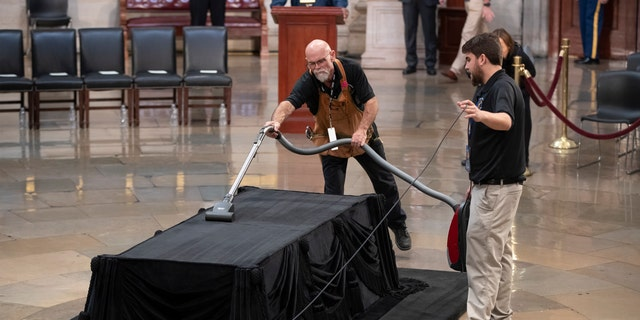 Mike Dean, lead upholsterer for the House of Representatives, and John Brady Jr., an apprentice, prepare the Lincoln catafalque for the casket of former President George H.W. Bush.