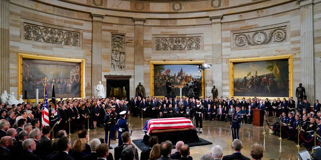 Vice President Mike Pence, right, speaks at the podium during services for former President George H.W. Bush in the Capitol Rotunda on Monday.