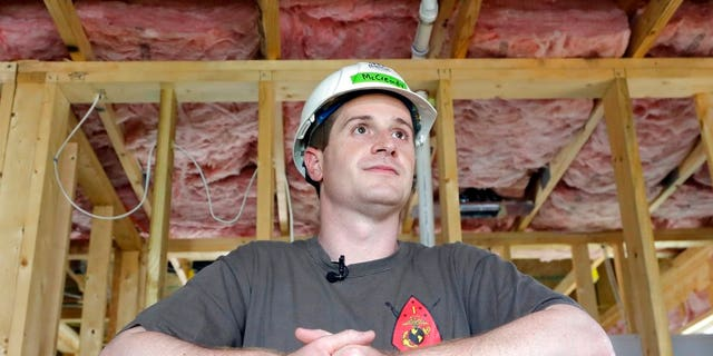FILE - In this Sept. 26, 2018, file photo, Democratic congressional candidate Dan McCready leans against wallboard as he pauses during a Habitat For Humanity building event in Charlotte, N.C. (AP Photo/Chuck Burton, File)