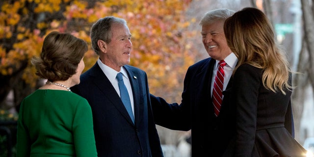 President Donald Trump and first lady Melania Trump are greeted by former President George W. Bush and former first lady Laura Bush outside the Blair House.