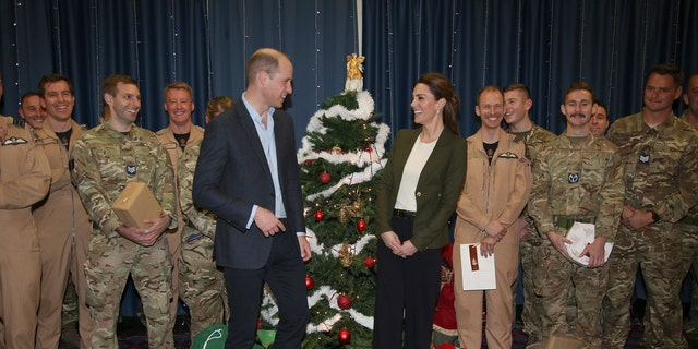 Prince William and Kate Duchess of Cambridge pose with Service Personnel during a Christmas party on RAF Akrotiri in Cyprus, as the Royal couple visit the Sergent's mess to hand out gifts Wednesday Dec. 5, 2018. The RAF Akrotiri is the home of the Cyprus Operations Support Unit which supplies support to operations in the region to protect the UK's strategic interests.