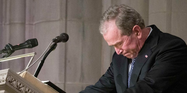 Former President George W. Bush becomes emotional as he speaks at the state funeral for his father, former President George H.W. Bush, at the National Cathedral.