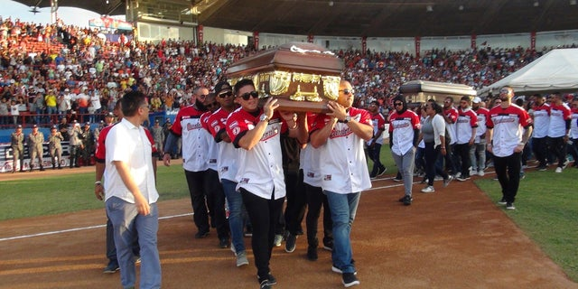 Players from a Cardenales de Lara ball group lift a caskets of teammates and former vital joining players Luis Valbuena and Jose Castillo during a ball track in Barquisimeto, Venezuela on Friday.