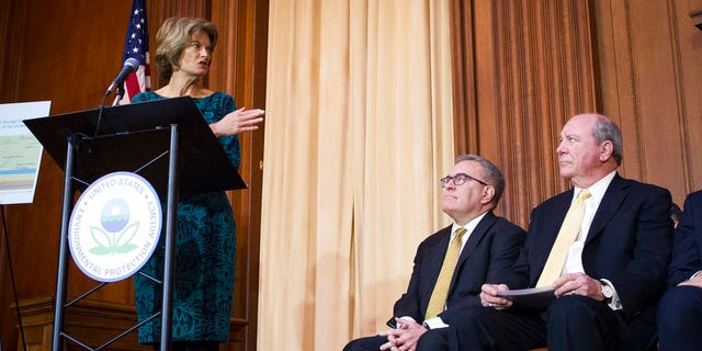 "Sen. Lisa Murkowski, R-Alaska, gesturing towards Acting EPA Administrator Andrew Wheeler, center, and Assistant Secretary of the Army for Civil Works Rickey ""RD"" James, after Wheeler signed an order withdrawing federal protections for countless waterways and wetlands. (AP Photo/Cliff Owen)"
