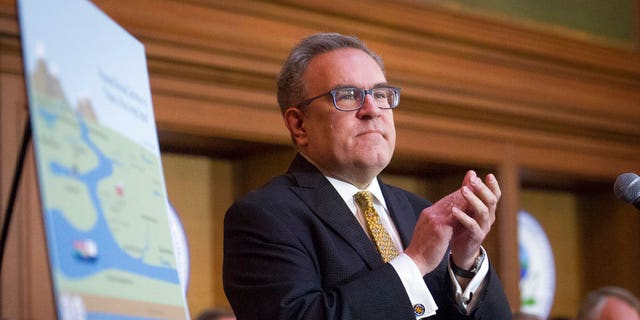 Acting Environmental Protection Agency administrator Andrew Wheeler speaking after signing an order withdrawing federal protections for countless waterways and wetlands at EPA headquarters in Washington on Tuesday. (AP Photo/Cliff Owen)