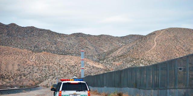 A U.S. Border Patrol agent patrols Sunland Park along the U.S.-Mexico border next to Ciudad Juarez.