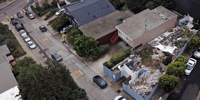 This Friday, Dec. 14, 2018, photo shows a demolished house, right, on a property in San Francisco.