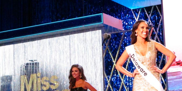 Miss Delaware Joanna Wicks introduces herself at the start of the third and final night of preliminary competition at the Miss America competition in Atlantic City N.J. (Associated Press)