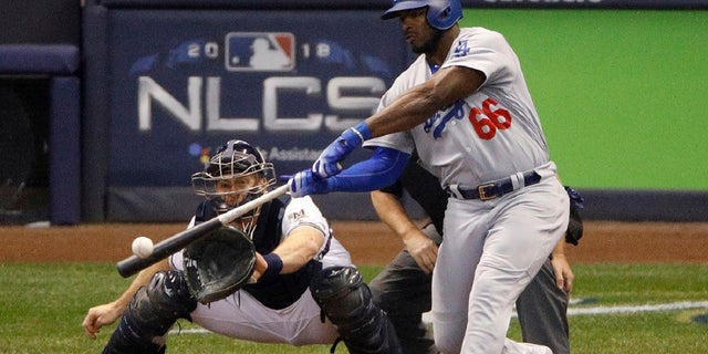 FILE:Los Angeles Dodgers' Yasiel Puig (66) hits a three -run home run during the sixth inning of Game 7 of the National League Championship Series baseball game against the Milwaukee Brewers in Milwaukee,Oct. 20, 2018.