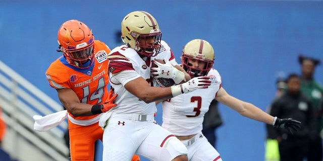 Boston College running back AJ Dillon (2) scores a touchdown ahead of Boise State cornerback Tyler Horton (14) during the first half of the First Responder Bowl NCAA football game Wednesday, Dec. 26, 2018, in Dallas. But the score won't count because the game was later canceled. (Associated Press)