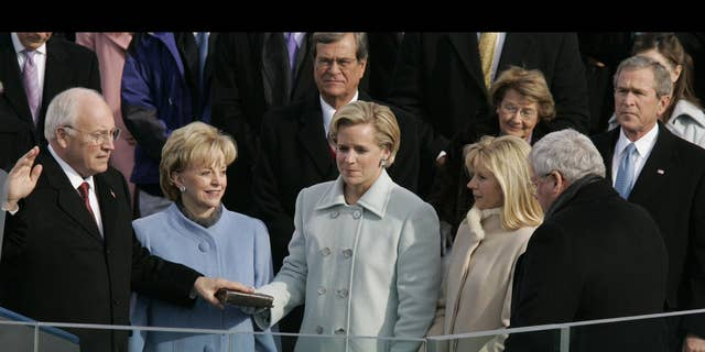 Richard Cheney, as US Vice President, sworn in by Speaker of the House Dennis Hastert, as wife Lynne and daughters Mary and Elizabeth watch, US Capitol, Washington DC in 2005.