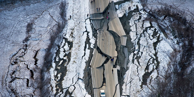 Aerial photo shows damage on Vine Road, south of Wasilla, Alaska, after earthquake Friday. (Marc Lester/Anchorage Daily News via AP)