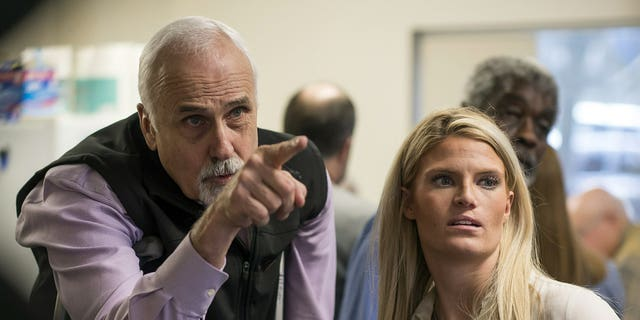 Alaska House District 1 candidate Republican Bart LeBon points to a vote tally board with his campaign manager Brittany Hartmann during a election recount at the Department of Elections' Juneau office on Friday, Nov. 30, 2018.
