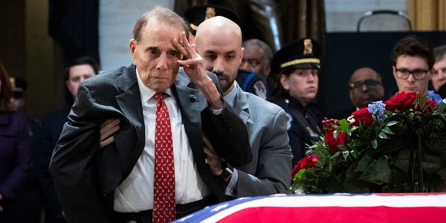 In one of the more touching moments of former President George H.W. Bush's funeral, former Sen. Bob Dole stood up and saluted the casket of the late president. (Photo by Drew Angerer/Getty Images)