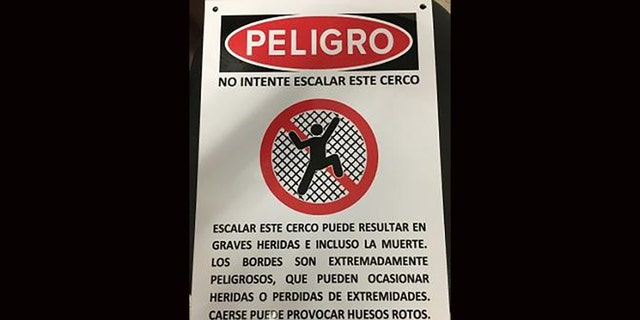 Signs are located in multiple locations along the wall where the pair fell, warning about the dangers of scaling the structure.
