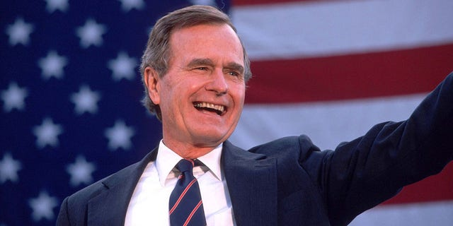 George Bush waves to a crowd of supporters Nov. 5, 1988. Bush and his running mate Dan Quayle defeat Michael Dukakis in the Presidential election. His efforts to reduce the deficit failed while creating the lowest growth period since the Great Depression. (Photo by Cynthia Johnson/Liaison)